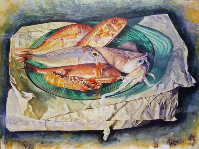 Pesci su piatto verde