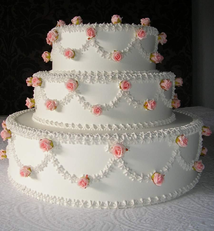 torta matrimoniale diam. 45 x 35 cm h decorata con roselline rosa