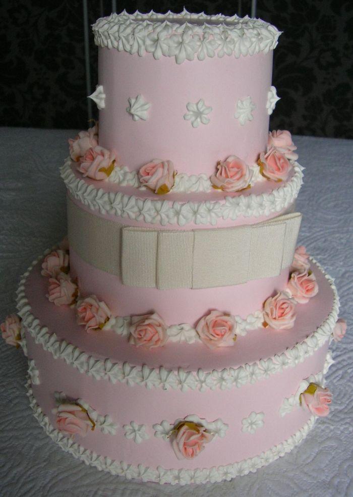 torta a 3 piani rosa spatolato